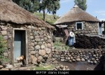 Traditional Basotho rondoval house made of stone with a thatch roof in Lesotho, Southern Africa