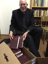 Prof. Dr. John Nordling bringing Lutheran Hymnals for the Seminary